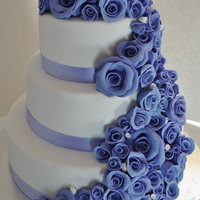 Purple/ Mauve Wedding Cake With Handmade Roses purple/ mauve wedding cake with handmade roses. I did a lot of researching on how to get the flowers to STAY purple, since it always fades...
