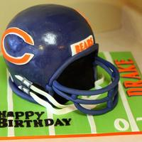 Chicago Bears Helmet Cake This is a large helmet cake (close to lifesize) made of three layers of vanilla cake and a Wilton's soccerball cake to top it off. It...