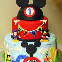 Drue's Mickey Mouse Clubhouse I made this cake for my nephew's 1st birthday. For this one I found such amazing inspiration here on Cake Central. I pulled a lot of...