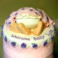 "Baby Girl Rumpcake I finally got to try my hand at this cute little baby rumpcake this weekend. How fun! It's a 10"" round cake with half of a Wilton..."