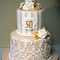 Damask 50Th Anniversary This is an anniversary cake I did for a good friend of mine who's parents were celebrating their 50th anniversary. I used the Cricut...