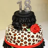 Cheetah Ruffles My second cake this weekend is a two tier (8 inch and 4 inch), vanilla with vanilla buttercream, covered and decorated in fondant. The 18...