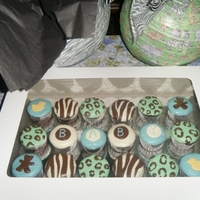 Animal Print Baby Shower Cupcakes Dark chocolate cupcakes, with dark chocolate frosting covered and decorated with fondant. My first time doing animal print fondant and...