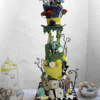 Alice In Wonderland Topsy-Turvy Wedding Cake five tiers cake with raised hat and forest of glowing mushroom on top