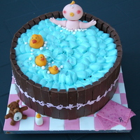 My First Baby Shower Cake chocolate, chocolate and more chocolate fondant figurines, with butter cream for the water,