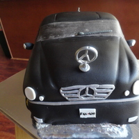 Mercedes Cake this is my first car cake. it was for my husbands birthday and i used pictures of his actual Mercedes for my guide.