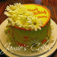 Daisy Mae   I made this cake for one of my mothers friends birthdays. Tangerine cake with CC Frosting. and silk daisy's