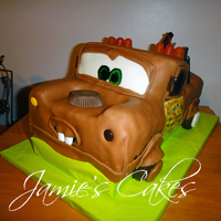 Tow Mater  This was for a friends grandson. Chocolate Cake with Chocolate BC Frosting and Covered in MMF. Decorated with Reese's peanut butter...
