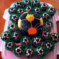 Soccer Cake   Strawberry Soccer Cake with Strawberry Cupcakes decorated with Cream Cheese Frosting.