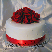 Anniversary Cake Chocolate Cake with Buttercream Frosting. Decorated with MMF, Red Ribbon & Red silk roses