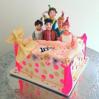One Direction Birthday Cake. 1D birthday cake. All figures, gift box, bow and other decoration made from gum paste. Such a fun cake to get creative with.