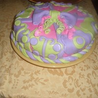 My First Fondant Cake this is my first fondant cake,,,the inside is Strawberry with buttercream icing and filling.