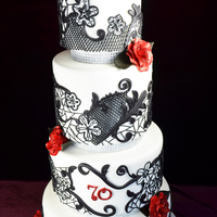 "Black Royal Icing Lace With Deep Red Roses This Was A Murder Mystery Themed 70Th Birthday Cake 6 Tiers Hand Piped Black royal icing lace with deep red roses. This was a murder mystery themed 70th birthday cake. 6"" tiers, hand-piped."