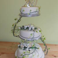 3 Tiered White Flower Wedding Cake On S-Shaped Stand