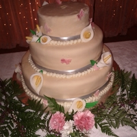 My First Wedding Cake   Three tiered wedding cake with fondant/gum paste calla lilies and butterflies.