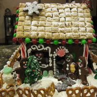 Gingerbread House Gingerbread house. Lots of candy, pretzels, cereal, and coconut.