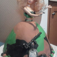 Military Barbie..... Watch Out G.i. Joe... Barbie cakeUsed Fondant... in camo designadded toys to add to the effect