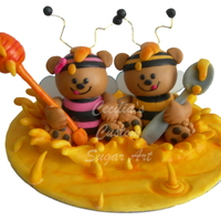 "Honey Bear Cake Topper - Sugarpaste This Topper is 7"" wide by 6"" high - This is made of Sugarpaste and is almost entirely edible except the spoon, honey stick and..."