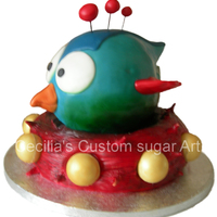Tiny Wings I made this cake for my son at his request. It is based on his favourite game Tiny wings. It is all cake and the wings,beak and spikes are...