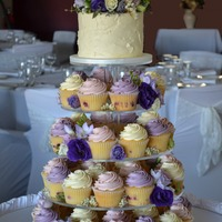 Floral Cupcake Tower   These cakes were vanilla and raspberry cupcakes and cake top covered in buttercream to match the bridesmaid dresses.