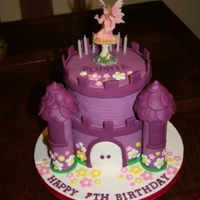 Purple Castle Cake This was my 1st big scale childrens birthday cake, this was for a fairy princess party. They were very happy with it and so was i!!!!!!