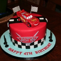 Cars Themed Birthday Cake This was my 1st cars (lightning McQueen cake. The car is a toy (wouldnt know where to start trying to replicate Lightning McQueen, took the...