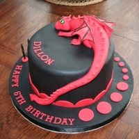 Black & Red Dragon Cake This was my 1st Dragon request, loved doing, a few hurtles and lesson's learned. Loving the black and red colour contrast.