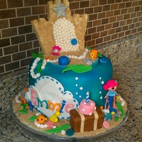 Coral Sea Shells Lalaloopsy This is a chocolate cookies and cream filled, and fondant decorated cake. The sandcastle is RKT, so is the gift, cake, and treasure chest....