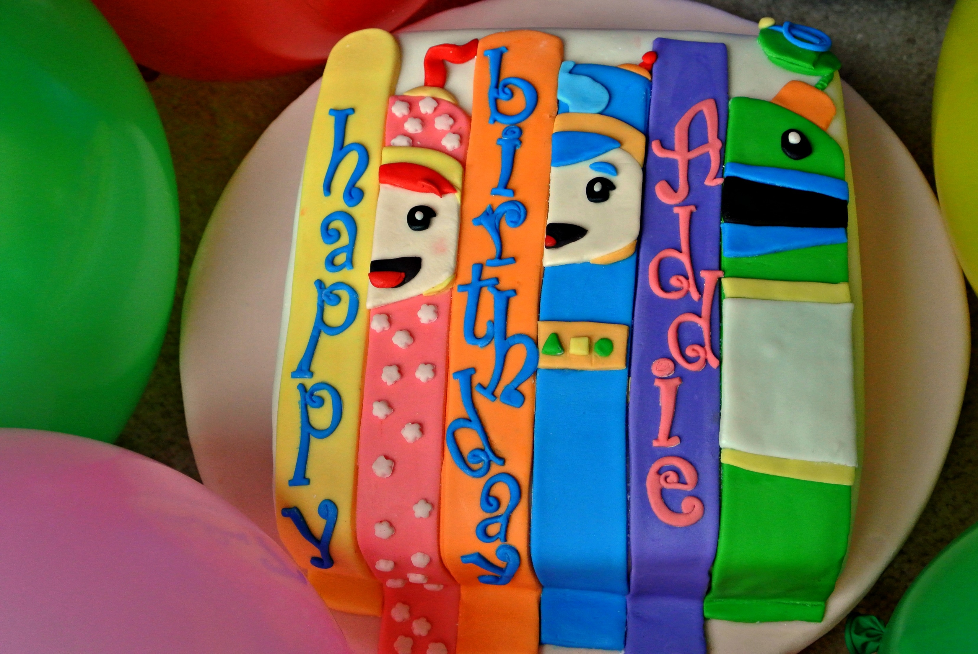 Team Umizoomi Millie, Geo, and Bot abstract birthday cake.