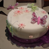 Buterflies fondand covered cake, with 3d buterfes and sparkley ribbonl