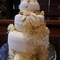 50Th Anniversary Fondant covered cake with white chocolate molded roses, and gold acents