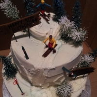 All Down Hill Buttercream cake with bc detailing, trees and skiing figures, with airbrushed accents