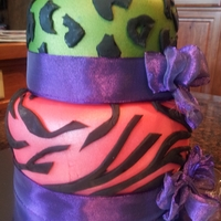 Wild One Fondant covered cake with an airbrushed wild side
