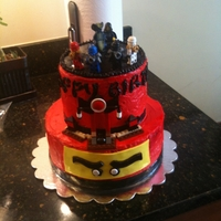 Ninjago Cake  Bottom tier - 2 layers of Devil's Food cake. Top tier - 2 layers of Devil's Food cake. Frosted with Swiss meringue buttercream....