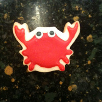 Crab Cookie   Simple sugar cookie with RI and purchased eyes. They are tiny, but so cute! And very easy to make.