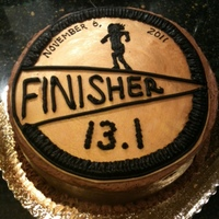 Finisher Medal Cake This is a cake I made for a friend who ran her first half marathon. It was a basic yellow cake with chocolate fudge icing. The top was made...