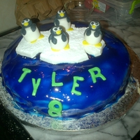 Tyler's 8Th Birthday Cake My son turned on Sat and this is cake I made him. 4 x penguins, floating on an ice drift on the top of the world. I used piping gel for the...