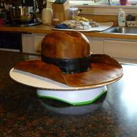 Cowboy Hat Cake First ever attempt at carving a cake......the carving went pretty well, but covering it in fondant however was a disaster!!! Normally, I...