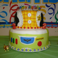 Toy Story Birthday This was my first cake i ever decorated and my first time working with fondant. This was for twin boys' 2nd birthday. They are Toy...
