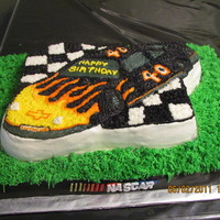 Nacar Cake For Friends 40Th Bday used wiltons race car pan, Buttercream and a sugar sheet for the bottom cake and the Nascar logo out of fondant