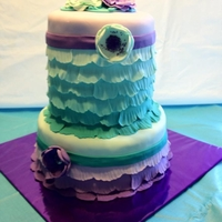 Ombre Ruffle Ruffle cake I did for my daughter's 9th birthday. teal and purple w/ flowers to match