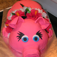 "Luau Pink Pig My first pink pig cake! Hand carved from 2 sheet cakes, 3 9"" rounds, and 1/2 of a ball cake. I had lots of scraps left over, but I was..."