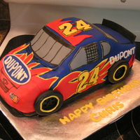 Jeff Gordon Cake Hand carved from 2 stacked sheet cakes. Fondant w/ fondant decorations