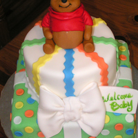 Winnie The Pooh The cake was designed to match the baby shower invitations. Pooh is made out of RKT and fondant......this was my first Pooh, so I'm...