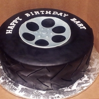"Tire Cake 10"" round cake. 2 layers. Black buttercream fondant."