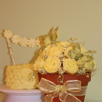 Cupcake Bouquet The bouquet is made of lemon cupcakes with lemon icing and the small cake is three layer chocolate cake with chocolate icing inside and...