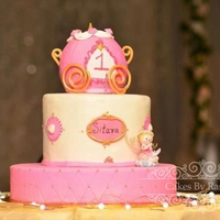 Princess Themed Cake The briefing i got from my client was pink carriage, atleast 3 tier cake with a figurine provided by the client.