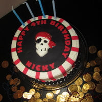 Pirate Birthday  This is a cake that I made for my son's friend Nicky's 4th birthday. It's a pirate themed cake with a white chocolate candy...