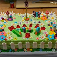 Garden Critters Cake  I made this garden critters cake for my neighbor's 3-yr-old daughter's birthday. Note the lack of a bumble bee. This was because...