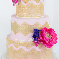 Blush And Gold Wedding Cake Blush and gold wedding cake with pink and purple florals